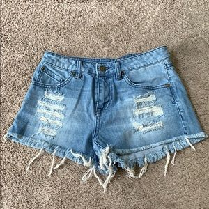 High waisted, distressed shorts.